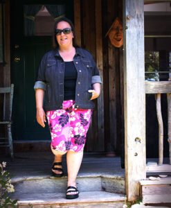 Woman wearing navy & pink spring ensemble made from Petite Plus Patterns 204 Jeans Jacket and 604 Capri Pant