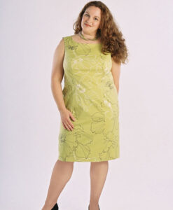 Model wearing Petite Plus Patterns 303 All Season Dress, sleeveless version in green stretch-woven rayon